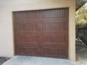 10x7 and 9x7 garage doors open box for Sale in Sanger, CA