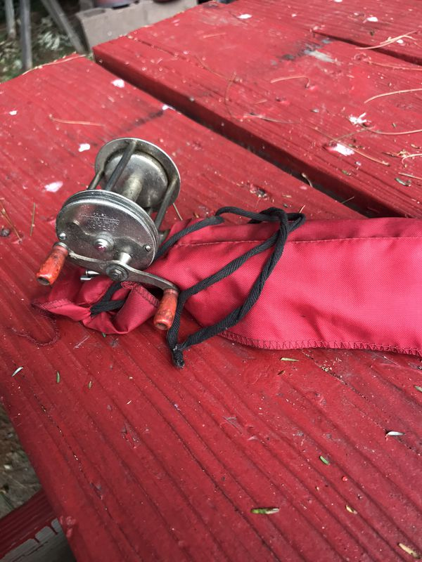 Vintage Antique wood fishing rod with reel