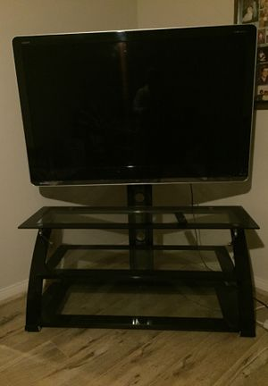 60 inch Sharp TV with 3 tier glass TV stand for Sale in Hacienda Heights, CA