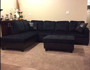 NEW black sectional couch on sealed box with ottoman and two pillows Delivery available is a business for Sale in Vancouver, WA