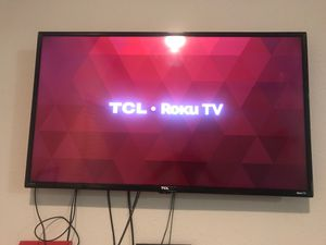 Tcl roku tv 40 inch .. perfect condition with wall mount panel / tv stand for Sale in Charlotte, NC