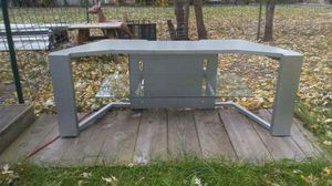 Silver TV stand in good condition one glass Shelf for Sale in Ottumwa, IA