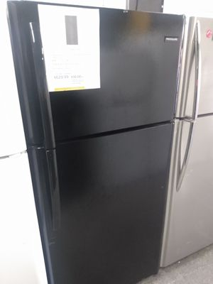 New scratch and dent Frigidaire top freezer fridge for Sale in Baltimore, MD