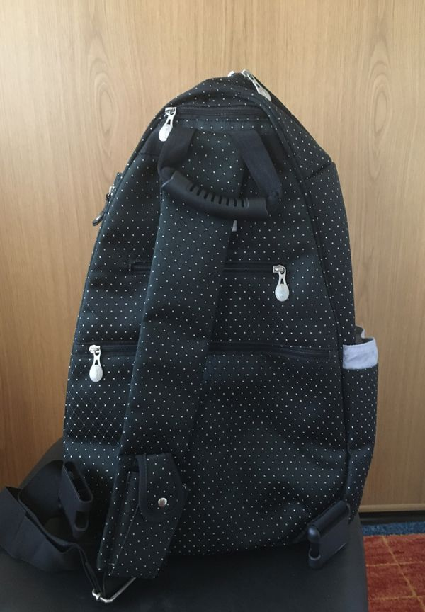 Jet pack life is tennis outfitted sling racket bag by Lynne Tauchen