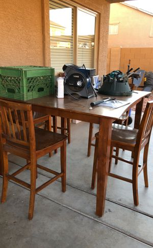 Table with five chairs solid wood for Sale in Phoenix, AZ