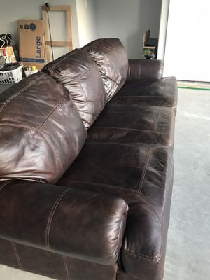 Brown leather couch from Ashley's furniture $250 for Sale in Dallas, TX