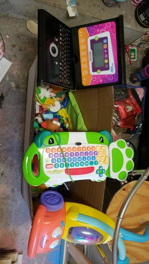 Box of random kids toys includes a leap frog click and start computer discovery kids lap top mr potato head a push vacuum for Sale in Jacksonville, FL