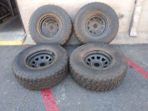 Jeep, Chevy, or GMC 5 lug 17 inch steel rims and mud tires for Sale in Montebello, CA