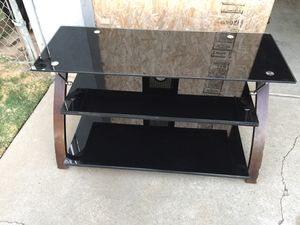 TV glass stand in very good condition. for Sale in Fresno, CA