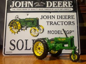 John Deere toy tractor (collectible) and John Deere sign (collectible) for Sale in Columbia, SC