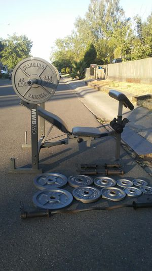 Weight bench-barbell-weights-curling bar-2 dumbbell bars-6 spring collars for Sale in Stockton, CA