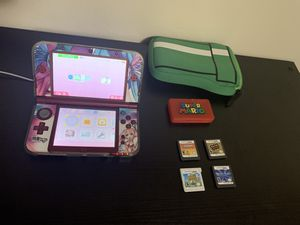 Nintendo 3DS XL with 4 games, charger and case for Sale in Indianapolis, IN
