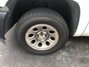 Set of 4 Silverado rims and tires for Sale in Kissimmee, FL