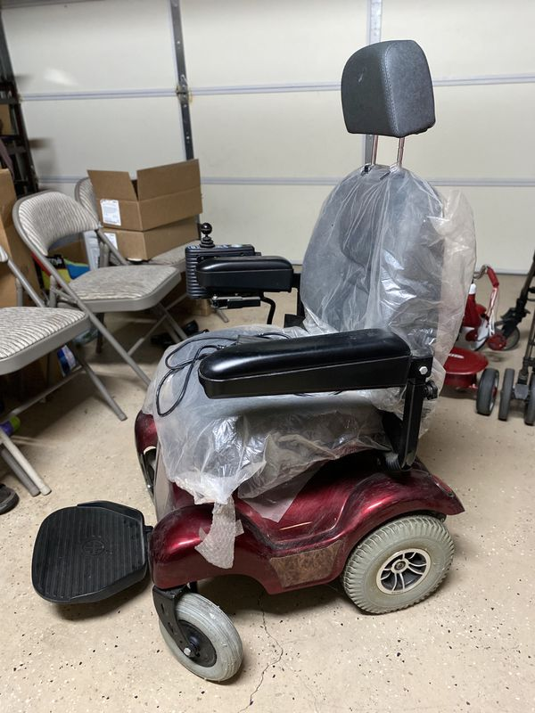MERITS Health Electric Wheelchair Red