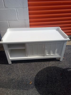 real Wood tv stand with shelves and sliding doors for Sale in Hyattsville, MD