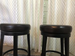 Two bar stools with cushioned seating and rotates for Sale in Chino Hills, CA