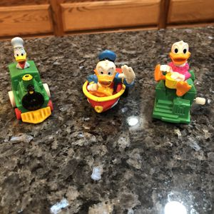 Collectible Vintage Disney Donald Duck Pull back Toy, a Boat And Daisy Duck Windup Toy Preowned for Sale in Artesia, CA