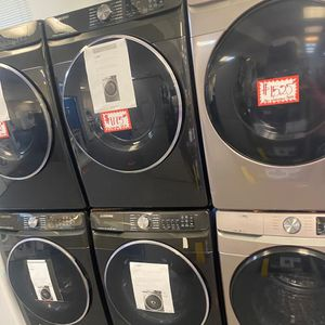 New Samsung front load washer and dryer set scratched and dented with 6 months warranty for Sale in Laurel, MD