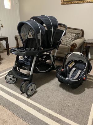 Double stroller with car seat for Sale in Northport, AL