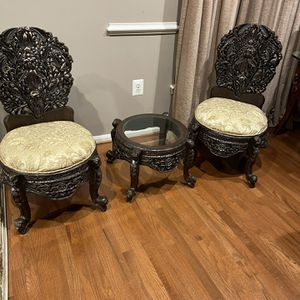 Solid Wood Handcraft carving to chair And one round glass table for Sale in Woodbridge, VA