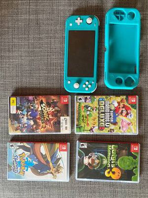 Nintendo Switch lite blue with games for Sale in New York, NY