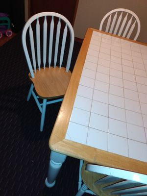 Table with 4 chairs, the table has a bit cracked tiles but it still works, it can also be covered with a tablecloth... THAT WHY THE LOW PRICE. for Sale in Kent, WA