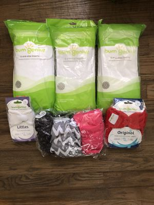 Cloth diapers. Bum Genius. A few open, but never used. 4 size adjustable, and one newborn. 3 packs of diaper liners. for Sale in Detroit, MI