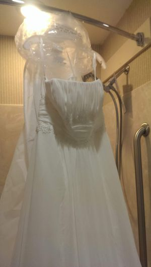 Nwt David's bridal wedding dress with veil. Only ever worn at store to try on. In mint condition. for Sale in Norfolk, VA