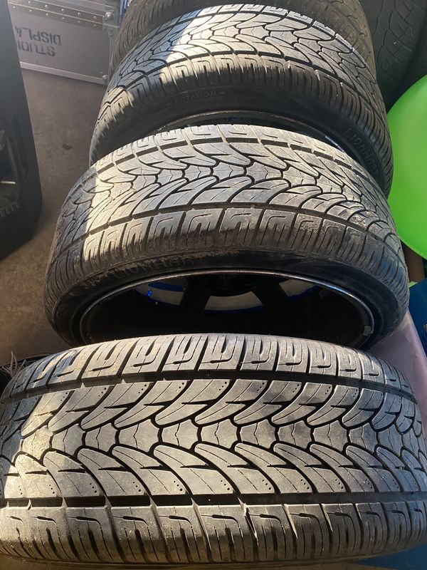 """Chrome and black 22"""" Rims with 4 like new tires and 3 like new spare tires universal bolt pattern will feet jeep Hyundai fords"""