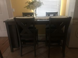 Like new Ashley furniture table and chairs for Sale in Emeryville, CA