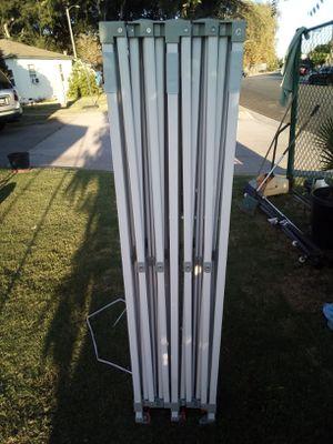 Carpa keymaya 10x20 con lona Blanca nueva y bolsas para la arena ( la abrí nada más para la foto ) Keymaya canopy 10x20 with white canopy new. for Sale in El Monte, CA