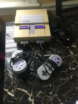Super Nintendo with two controls and two games is in good condition for Sale in Philadelphia, PA