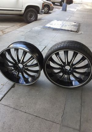 Rims 24 inches two with tires came off a 2001 caddi 500 for Sale in Fresno, CA
