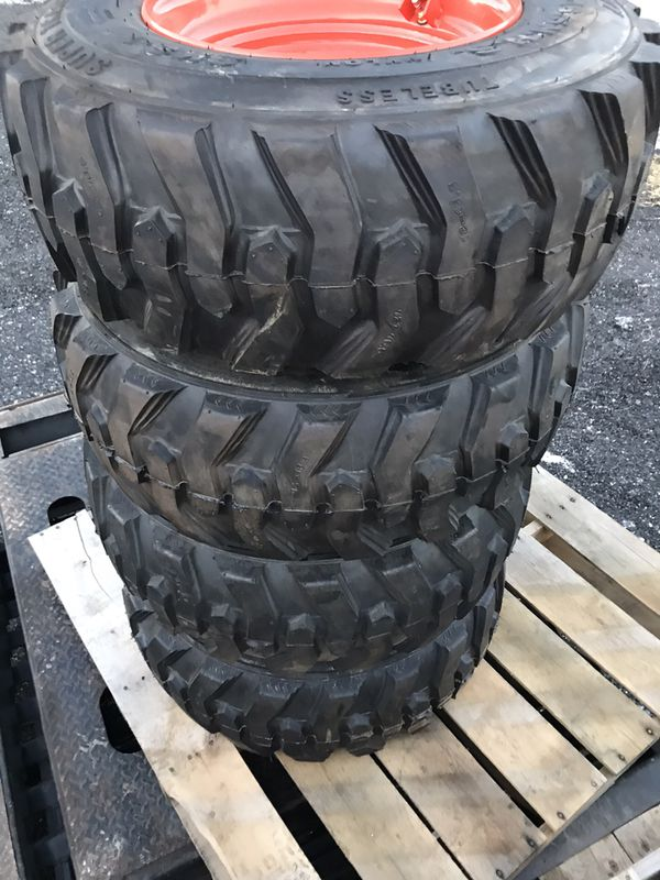 Snow pusher and skidloader tires and wheels
