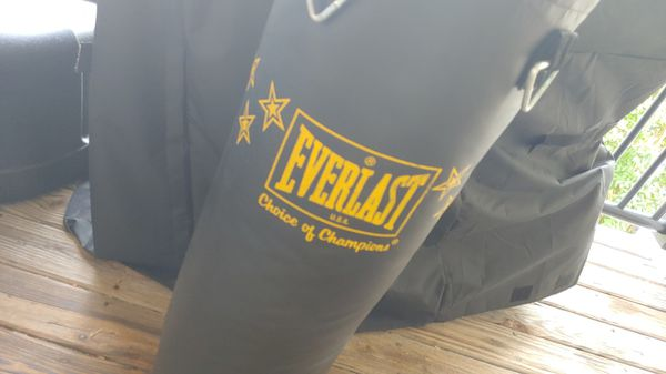 Boxing dummy and never used punching bag