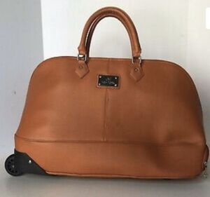 Joy Mangano leather rolling duffle with matching hand bag for Sale in Pembroke Pines, FL