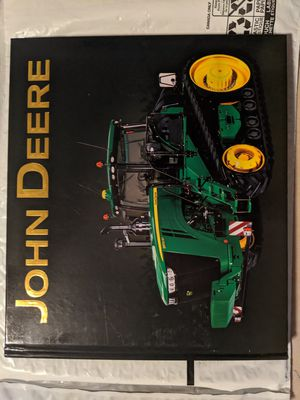 New John Deere Tractor hardcover book. Classic tractors modern industrial units and period ads join rare historic images for Sale in Utica, NY