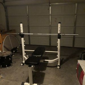 weight bench with olympic bar 45lbs for Sale in Nellis Air Force Base, NV