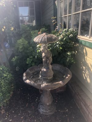 Fountain, girl and boy with umbrella for Sale in Turlock, CA