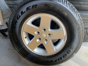 Set of 5 stock Jeep Wrangler wheels and tires for Sale in Tampa, FL