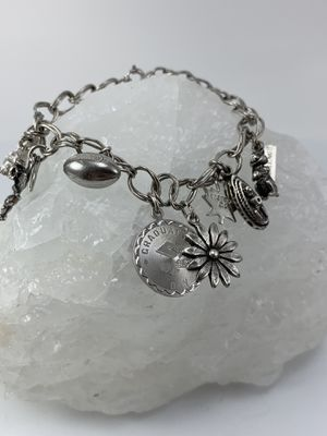 Silver 925 marked bracelet with different charms for Sale in Plainfield, IL