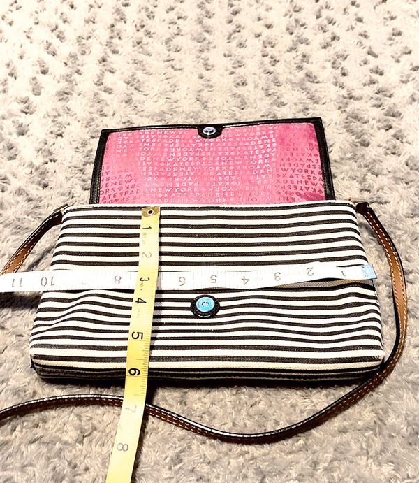 Kate Spade NY striped crossbody paid $325 Great condition! bag with sliver hardware, heart enamel accent at front, tan leather trim, flat shoulder st