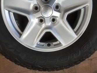 New Bridgestone Dueler A/T 245/75R17 tire on Jeep wheels for Sale in Woodinville,  WA