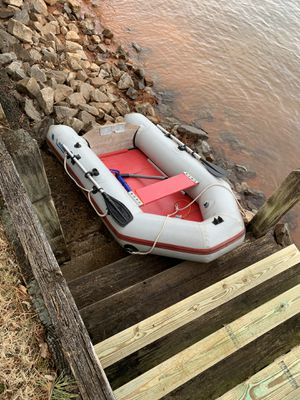 Nissan inflatable boat with motor and ores for Sale in Suwanee, GA