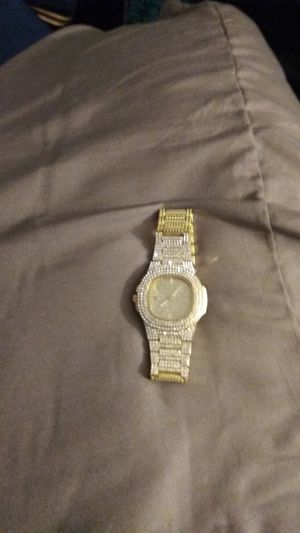 Gold Iced out realistic diamond watch for Sale in St. Louis, MO