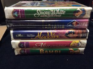 Snow White & seven dwarfs unopened Fantasia unopened with three used tapes Bambi,Aladdin,alice in wonderland the Aladdin in the diamond series for Sale in Las Vegas, NV
