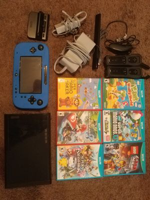 Nintendo Wii U Black Console 32GB Bundle + 6 Games, 3 controllers + a nunchuck & all controllers with covers. for Sale in Las Vegas, NV