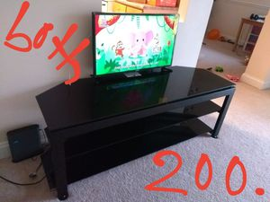 Full glass TV stand and Samsung smart TV for Sale in Herndon, VA