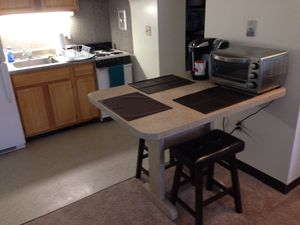 """Formica Counter/Table 36"""" high with 2 padded dark walnut stools included in price. for Sale in Brick, NJ"""