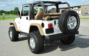 Excellent Quality 2001 Jeep Wrangler 4WDWheels for Sale in Naperville, IL